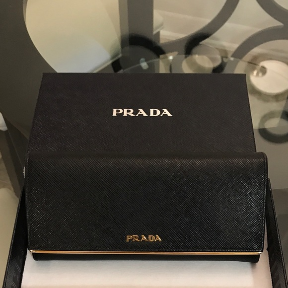 d2a9bcd765b593 Prada Bags | Saffiano Leather Flap Wallet With Metal Bar | Poshmark